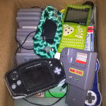 Cybiko, Gameboy Advance, a bunch of games, Gameboy Game Genie, and